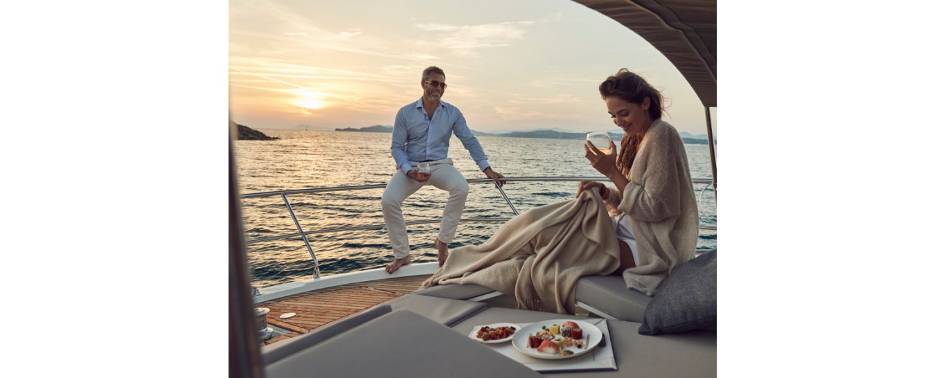 drinking wine on bow of yacht